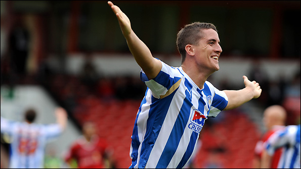 Andy Bond celebrates scoring against Walsall