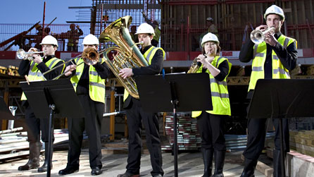 Photograph of the Royal Welsh College of Music & Drama's quintet, Castle Brass, on the site of the new concert hall