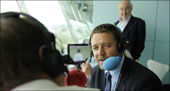 Russell Crowe speaks to Jonathan Agnew as Henry Blofeld looks on