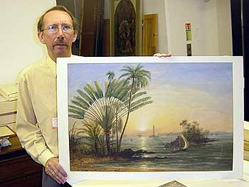 Martyn Anglesea of Ulster Museum holding painting of Galle Harbour, by Nicholl