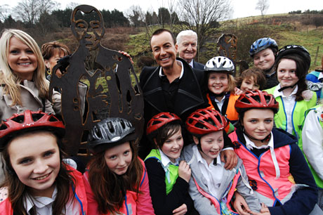 Julien Macdonald next to his steel sculpture in Merthyr. Photo: Sustrans