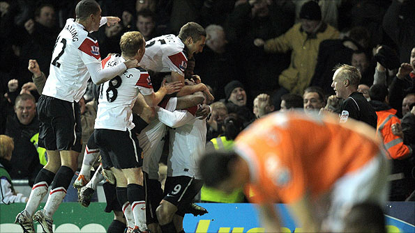 Scholes and Co celebrate a fantastic comeback to beat Blackpool 3-2