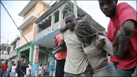 Haitian woman being rescued from rubble after earthquake