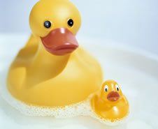 Two Yellow Rubber Ducks Actually Made From Plastic Floating On Soapy Water