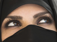 Muslim woman in niqab, with only her eyes showing. iStockphoto/Billie Muller