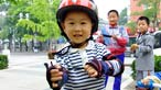 A child wearing a cycle helmet