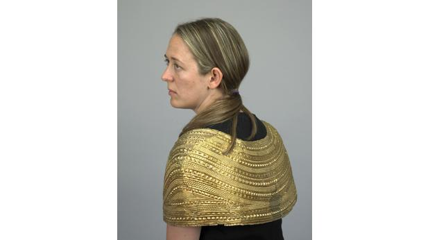 The Mold gold cape being worn. © Trustees of the British Museum