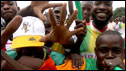Supporters of the Malian national football team clebrate at Quatro de Fevereiro International Airport in Angola's capital Luanda