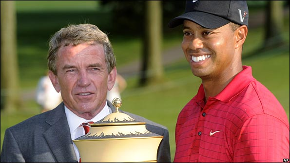 PGA Tour commissioner Tim Finchem poses with Tiger Woods after his win in the Bridgestone Invitational