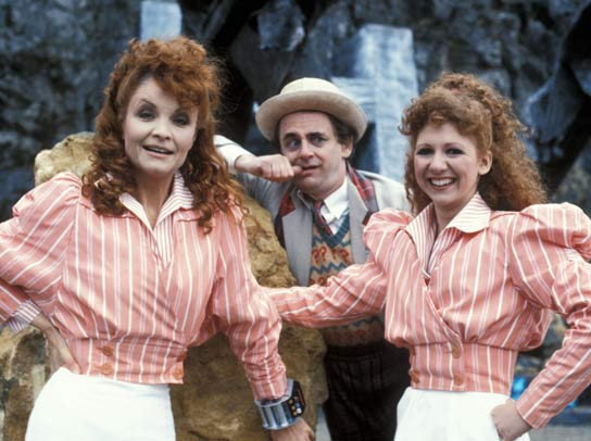Sylvester McCoy looks confused as Kate O'Mara and Bonnie Langford wear the same pink-and-white clothes.