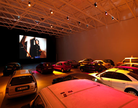 Phil Collins, Auto-Kino!, 2010. A stationary drive-in cinema with a curated programme of films and videos. Co-organised with Siniša Mitrović. Installation view, Temporäre Kunsthalle, Berlin - courtesy of Shady Lane Productions