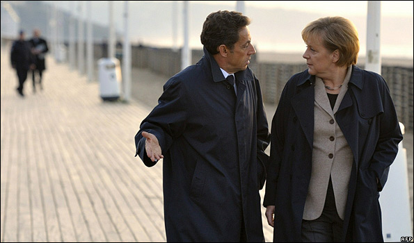 French President Nicolas Sarkozy and German Chancellor Angela Merkel on Deauville boardwalk, 18 Oct 10