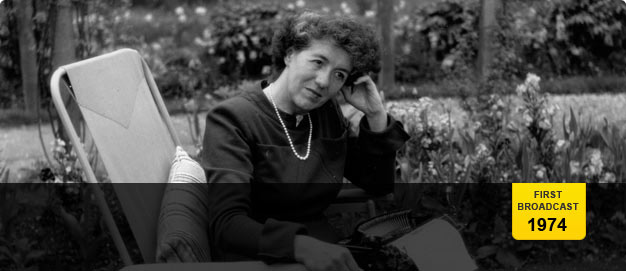 Enid Blyton photographed in her garden at 'Green Hedges'.