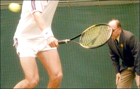 Brian Partridge, from Cheltenham, watches Tim Henman play at Wimbledon in 1997