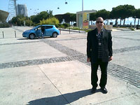 Peter Curran in Lisbon with a Nissan Leaf in the background.