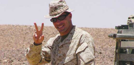 Picture of Arab-American soldier Muhammed Khaled in uniform making the victory sign