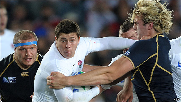 England scrum-half Ben Youngs is tackled by Scotland's lock Richie Gray as prop Euan Murray looks on during the 2011 Rugby World Cup