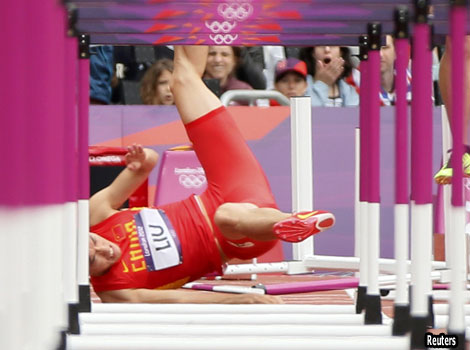 China's Liu Xiang falls at the first jump in the men's 110m hurdles.