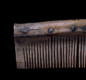 This is a Viking comb. It was made from deer antler, and had a case, so the comb-teeth did not break.