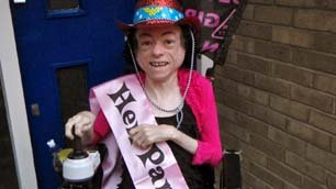 Liz Carr in her hen night hat and sash