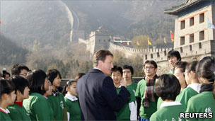 David Cameron talking to students by the Great Wall of China