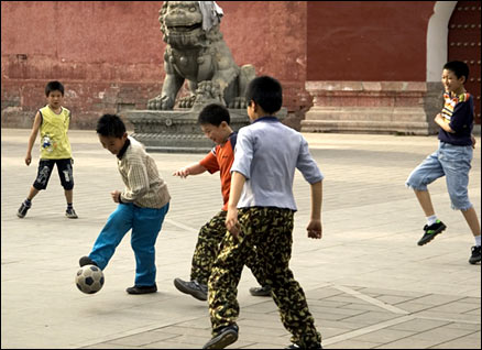 CHILDREN PLAYING FOOTBALL IN DONGCHENG