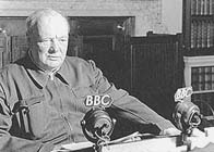 Black and white photograph showing Winston Churchill in a BBC studio wearing a boiler suit