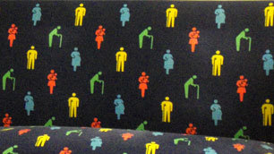 Priority seats on the Tokyo underground, with symbols of disabled people in the upholstery pattern