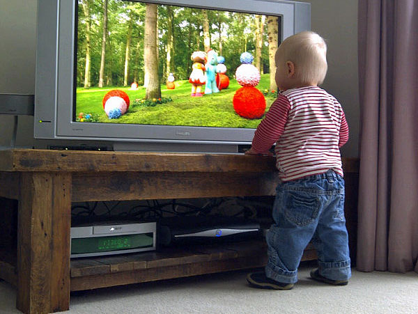 A young fan gets up and close to observe the finer detail of In the Night Garden.