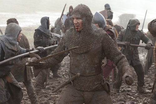 Tom Hiddleston covered in mud as Prince Hal in Henry IV part 1