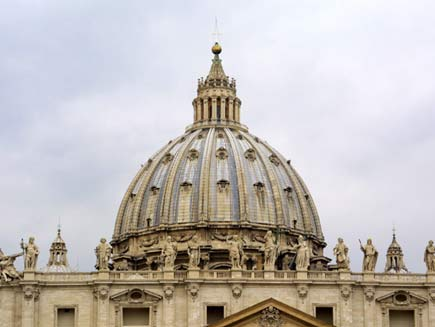 Dome of Saint Peter's Basilica with statues of the saints along the top of the walls