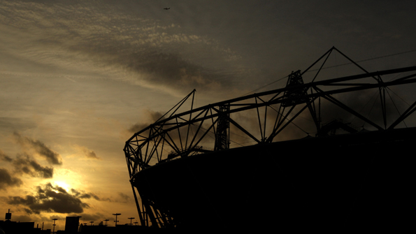 The sun seen behind the Olympic Stadium at London's Olympic Park