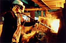 Molten iron being poured into steel-making furnace