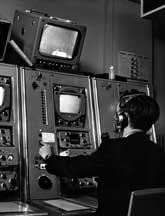 Technician at work in Television News control gallery, 1959