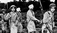 Blindfolded Japanese prisoners are led to the rear of the Chinese lines by Chinese soldiers after their capture on the fighting front in Northern Burma