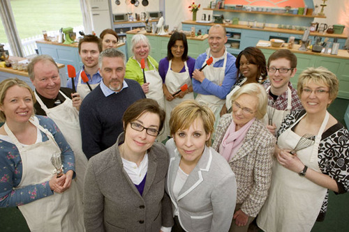 Great British Bake Off hosts Mel and Sue surrounded by the judges and contestants