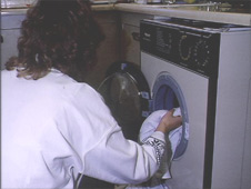 Putting clothes in Washing Machine, Housewife, 1990