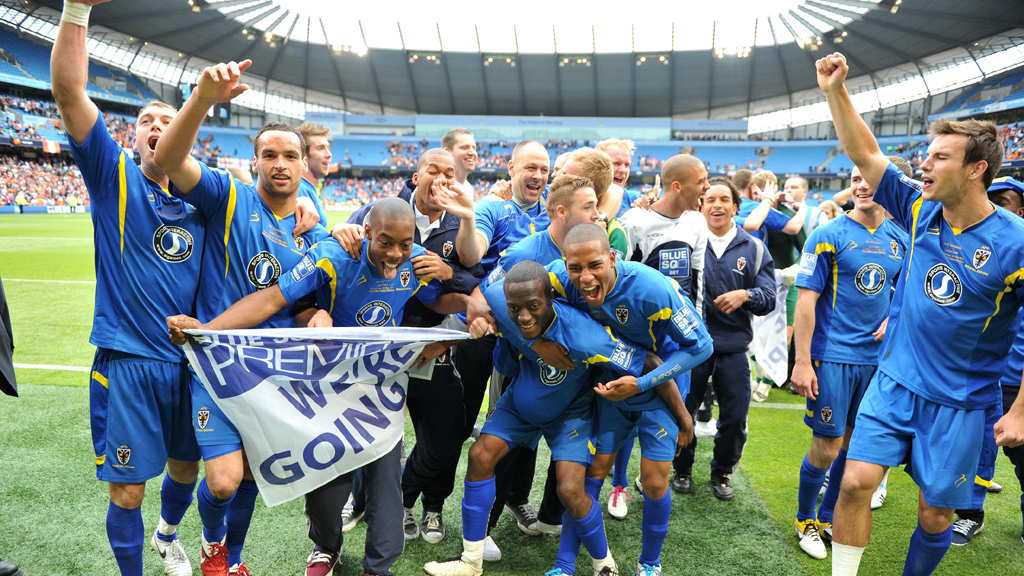AFC Wimbledon celebrating promotion to the Football League