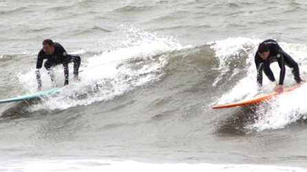 Surfers dropping in. Image by Mark Evans