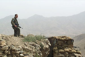Soliders keep watch over the city from the Kabul Gates observation post