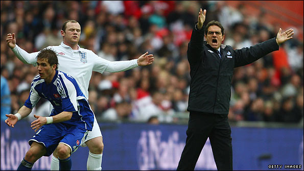 Wayne Rooney (left) and Fabio Capello during the friendly against Slovakia