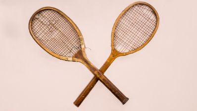 Two old wooden tennis racquets.