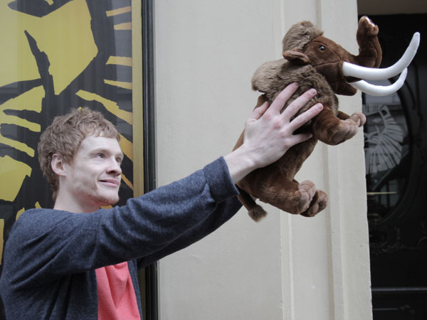 Andrew and a woolly mammoth recreate the iconic Circle of Life pose from The Lion King