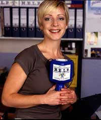 A smiling woman holding a charity collection box