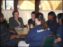 The BBC's Jon Kelly talks to teenagers at Menches Brothers hamburger restaurant in Akron, Ohio
