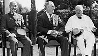 China's Generalissimo Chiang Kai-Shek; US President Franklin Roosevelt and British Prime Minister Winston Churchill, seated together on the lawn during the historic Cairo conference