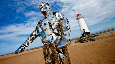 The Keeper sculpture on Talacre beach with Point of Ayr lighthouse in the background. Images courtesy Phil Thomas.