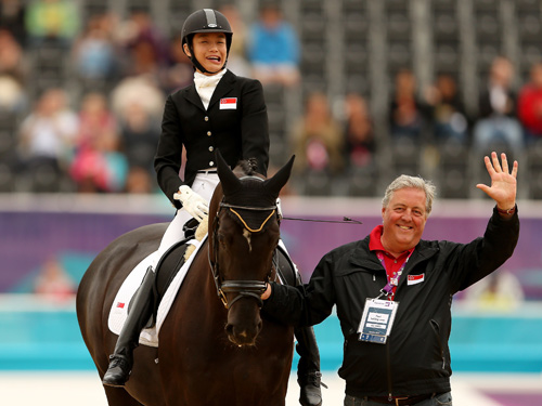 Laurentia Tan (left) competes in London 2012 Paralympic dressage