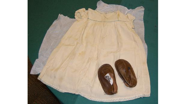 Set of baby's dress and shoes