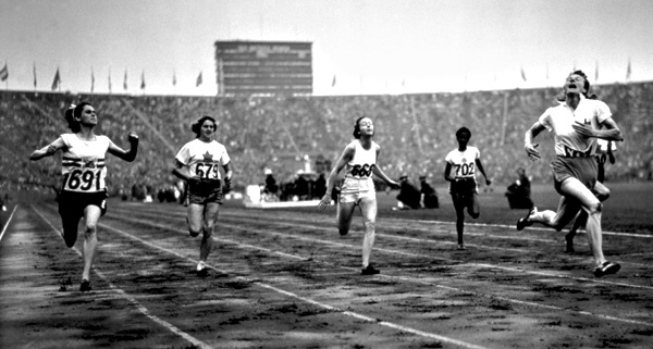 Fanny Blankers-Koen of the Netherlands finishes first in the Women's 100m during the XIV Olympic Games